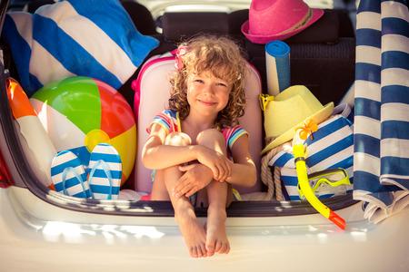 Photo pour Child going on summer vacation. Car travel concept - image libre de droit
