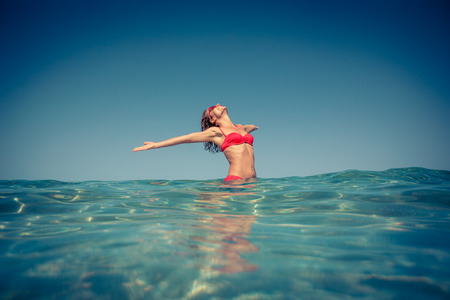 Photo for Young woman enjoying in the sea. Summer vacation concept - Royalty Free Image