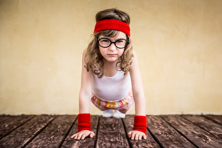 Photo pour Funny strong child. Girl power and feminism concept - image libre de droit