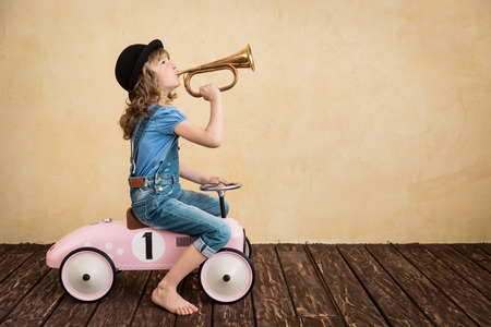 Photo for Happy child playing at home. Car trip. Summer vacation and travel concept - Royalty Free Image