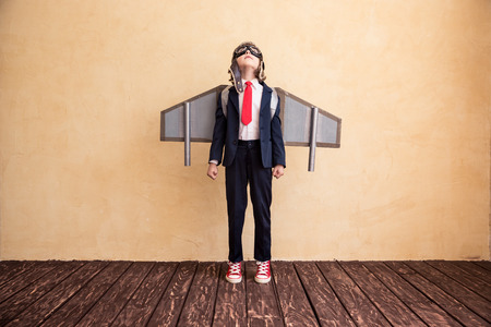 Photo pour Portrait of young businessman with toy paper wings. Success, creative and startup concept. Copy space for your text - image libre de droit