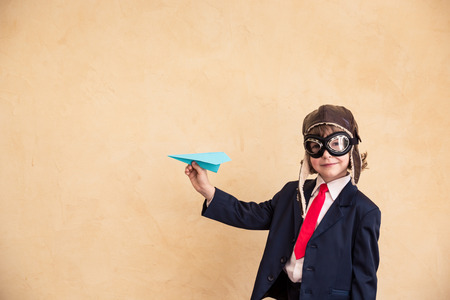 Photo pour Portrait of young businessman with paper airplane. Success, creative and startup concept. Copy space for your text - image libre de droit