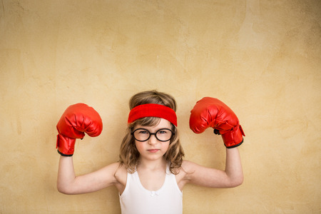 Photo for Funny strong child. Girl power and feminism concept - Royalty Free Image