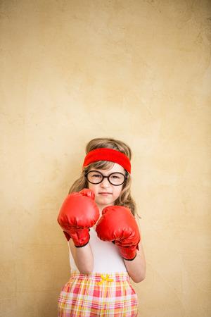 Foto de Funny strong child. Girl power and feminism concept - Imagen libre de derechos