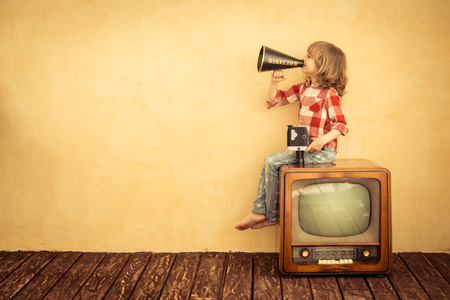 Photo pour Kid shouting through vintage megaphone. Communication concept. Retro TV - image libre de droit