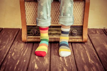 Foto de Kid listen music at home. Hipster child with retro vintage radio - Imagen libre de derechos