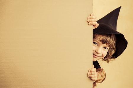 Foto de Funny child dressed witch costume. Halloween holidays concept - Imagen libre de derechos