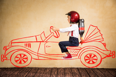 Foto de Portrait of young businessman with jet pack riding drawing retro car. Success, creative and innovation technology concept. Copy space for your text - Imagen libre de derechos