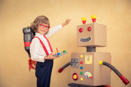Photo pour Portrait of young businessman with toy robot in modern loft office. Success, creative and innovation technology concept. Copy space for your text - image libre de droit