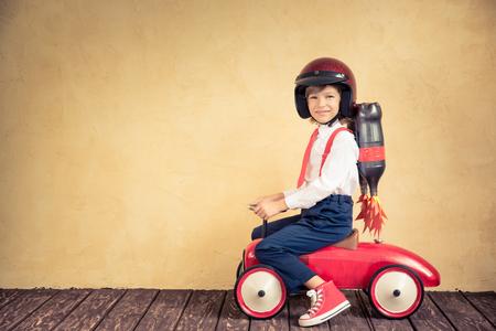 Foto de Portrait of young businessman with jet pack riding retro car. Success, creative and innovation technology concept. Copy space for your text - Imagen libre de derechos