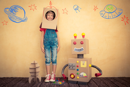 Photo for Happy kid playing with toy robot at home. Innovation technology and success concept - Royalty Free Image