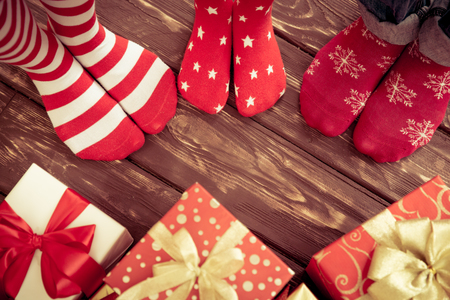 Photo pour Feet of family on wood floor. Christmas holidays concept - image libre de droit