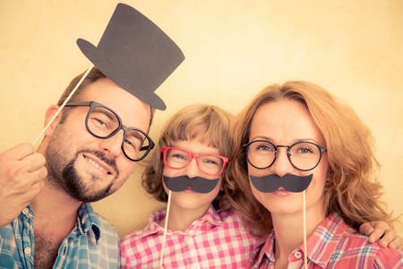 Photo pour Family with fake mustache - image libre de droit