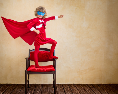 Photo pour Superhero kid at home. Christmas holiday concept - image libre de droit