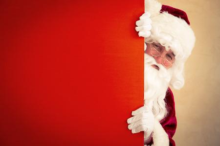 Photo pour Santa Claus holding banner blank. Christmas holiday concept - image libre de droit