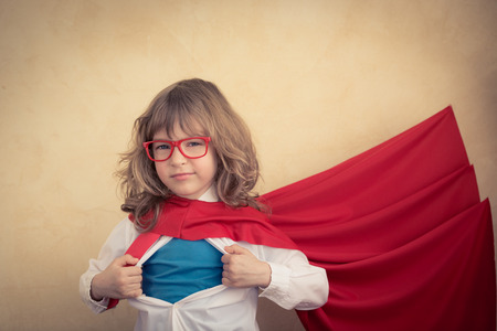 Photo pour Portrait of young superhero kid businessman in office. Success, creative and innovation concept - image libre de droit