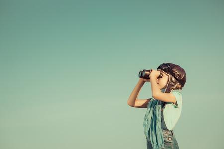 Foto de Happy kid playing outdoors. Travel and adventure concept - Imagen libre de derechos