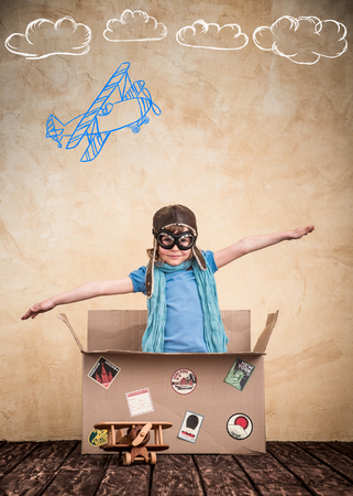 Foto de Child is pretending to be a pilot. Kid playing at home. Travel, freedom and imagination concept - Imagen libre de derechos