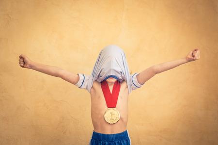 Foto de Child is pretending to be a soccer player. Success and winner concept - Imagen libre de derechos
