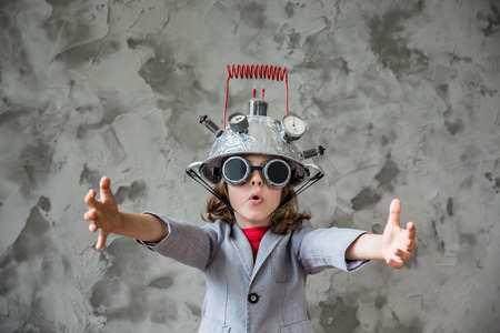 Foto de Portrait of young child pretend to be businessman. Kid with toy virtual reality headset in modern loft office. Success, creative and innovation technology concept. Copy space for your text - Imagen libre de derechos