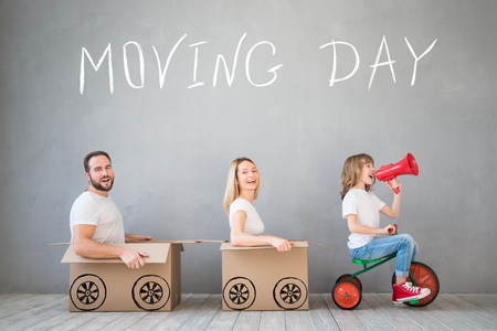 Photo for Happy family playing into new home. Father, mother and child having fun together. Moving house day and express delivery concept - Royalty Free Image
