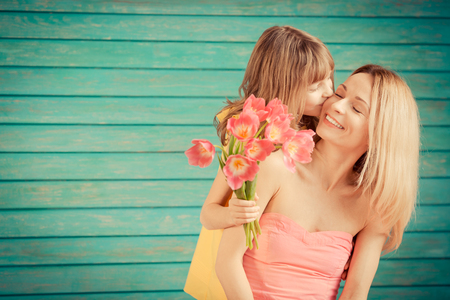 Photo pour Woman and child with bouquet of flowers against green background. Spring family holiday concept. Mother's day - image libre de droit