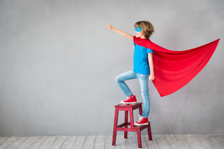 Foto de Child pretend to be superhero. Superhero kid. Success, creative and imagination concept - Imagen libre de derechos