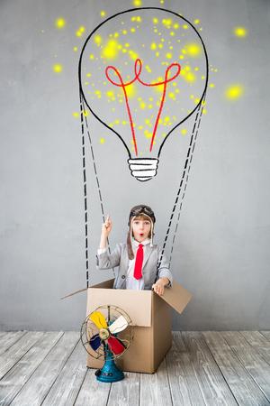 Foto de Portrait of young child pretend to be businessman. Kid playing at home. Imagination, idea and creative concept. Copy space for your text - Imagen libre de derechos