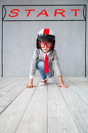 Foto de Child pretend to be businessman. Kid playing at home. Imagination, idea and creative concept. Copy space for your text - Imagen libre de derechos