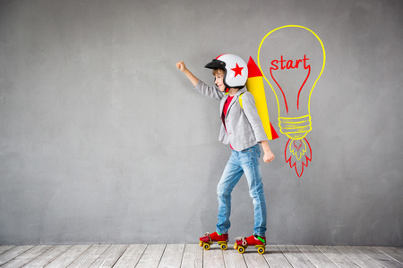Photo pour Child pretend to be businessman. Kid playing at home. Imagination, idea and creative concept - image libre de droit