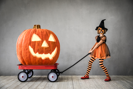 Photo for Funny child dressed witch costume. Kid painted terrible pumpkin. Halloween autumn holiday concept - Royalty Free Image