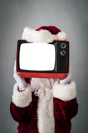 Foto de Santa Claus holding retro TV with screen blank. Christmas Xmas holiday concept - Imagen libre de derechos