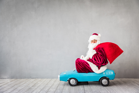 Foto de Santa Claus riding car. Christmas Xmas holiday concept - Imagen libre de derechos