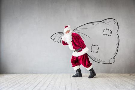 Photo pour Santa Claus holding bag. Christmas Xmas holiday concept - image libre de droit