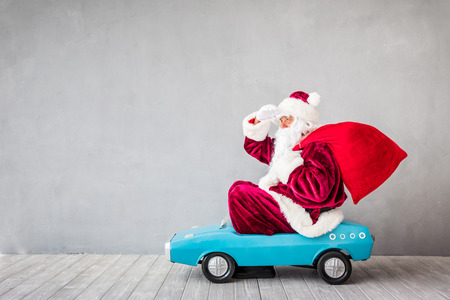 Photo pour Santa Claus riding car. Christmas Xmas holiday concept - image libre de droit