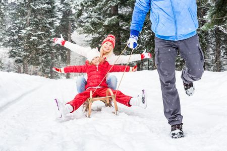 Photo for Happy family having fun outdoor. Child, mother and father playing in winter time. Active healthy lifestyle concept - Royalty Free Image