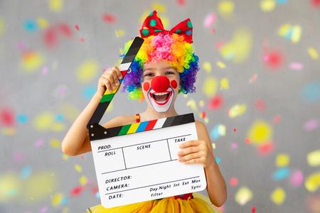 Foto de Funny kid clown. Happy child playing at home. 1 April Fool's day concept - Imagen libre de derechos