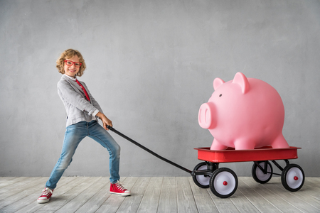 Photo for Child with giant piggy bank. Success, finance and investment concept - Royalty Free Image