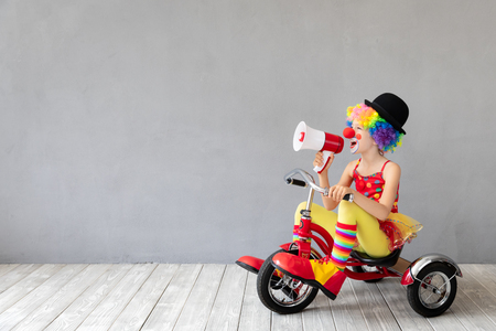 Photo pour Funny kid clown. Happy child playing at home. 1 April Fool's day concept - image libre de droit