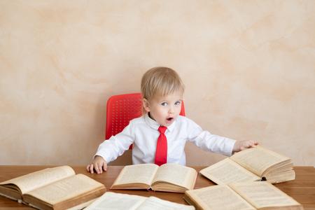 Foto de Surprised child pretend to be businessmen. Funny kid playing at home. Education, start up and business idea concept - Imagen libre de derechos
