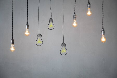 Photo for Many light bulbs against concrete wall background. Idea concept - Royalty Free Image
