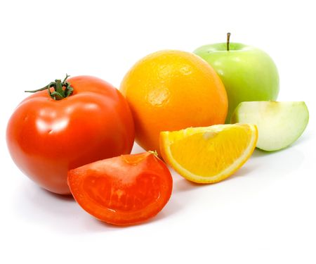 apple orange and tomato fruits with cuts isolated over white background