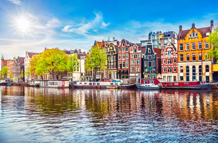 Photo pour Amsterdam Netherlands dancing houses over river Amstel landmark in old european city spring landscape. - image libre de droit