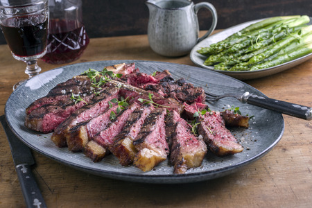 Photo for Wagyu T-Bone Steak with Green Asparagus on Plate - Royalty Free Image
