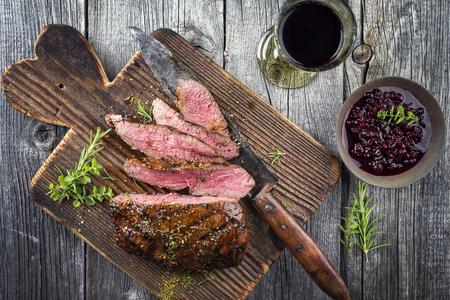 Photo pour Vanison steak on old cutting board - image libre de droit
