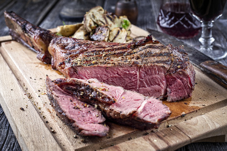 Photo for Barbecue Tomahawk Steak on Cutting Board - Royalty Free Image
