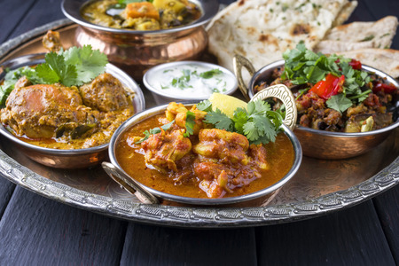 Photo for Indian Dishes on traditional Thali - Royalty Free Image