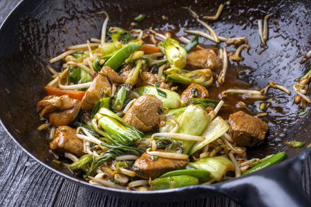 Photo for Traditional stir fried Chicken Gung Bao with Vegetable as close-up in Wok - Royalty Free Image