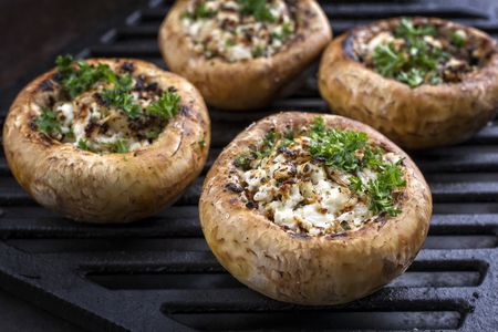 Photo pour Traditional Italian Mushroom Caps stuffed with Feta as close-up on a grillage - image libre de droit