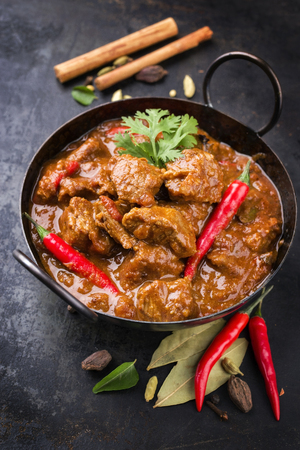 Photo for Traditional Indian curry lamb masala as close-up in a Korai - Royalty Free Image